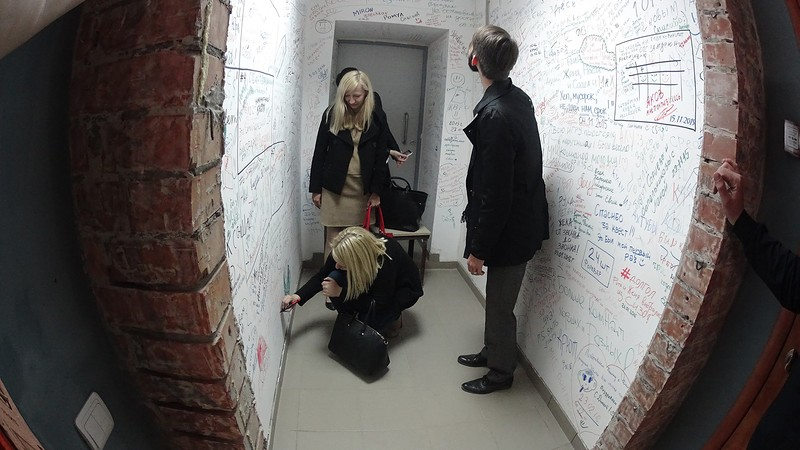 Players are solving a puzzle in an escape room.
