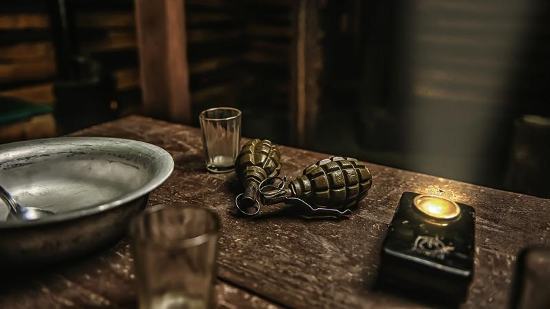 A pair of grenades in a Russian escape room.