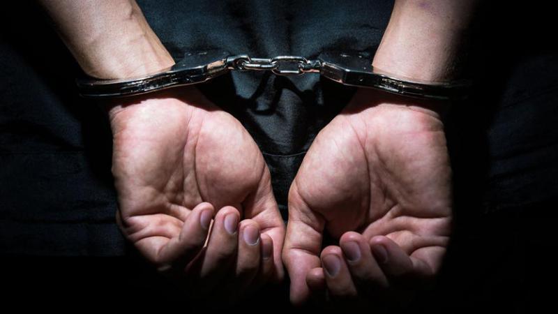 Prisoner in handcuffs.