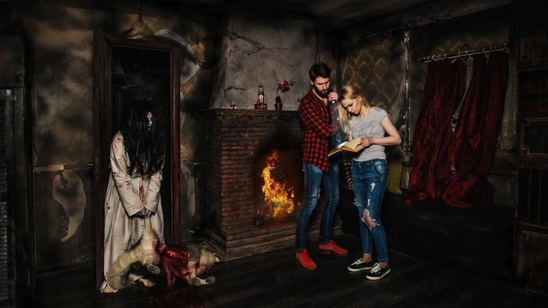 Couple solves puzzles in a horror escape room