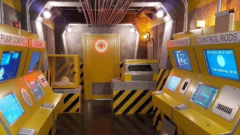 Old-fashioned arcade escape room with primitive consoles.