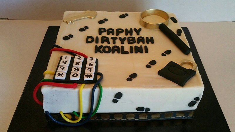 Cake shaped like a puzzle box with steps and a number panel on it.