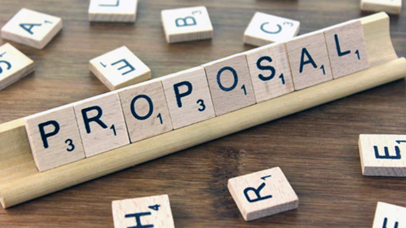 "Puzzle that is solved with the word ""PROPOSAL."""