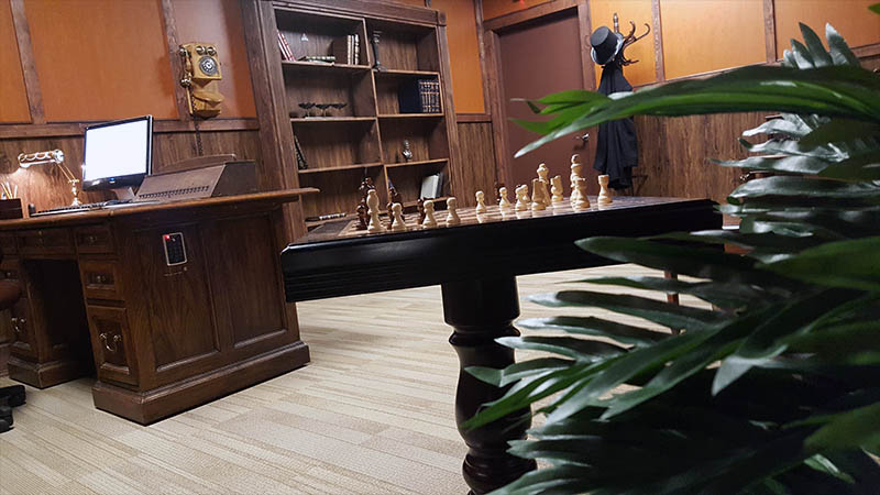 The chess table in the middle of the room is only a minor puzzle element. To get out, your employees will have to solve many riddles together.