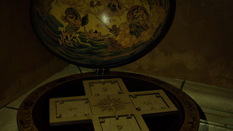To solve the problem in the castle escape room, the players must interact with the plates. But the globe is so distracting that it's hard to figure out what to do next!