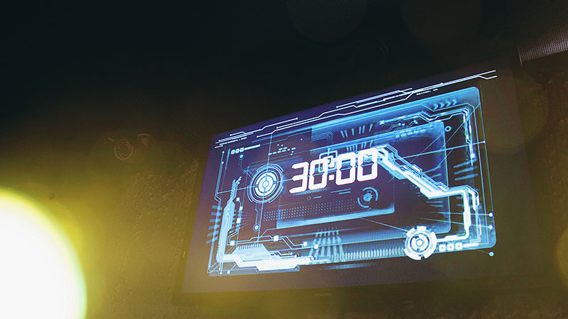 The blue electronic display glows in a dark room. The players only have 30 minutes left to finish the quest.