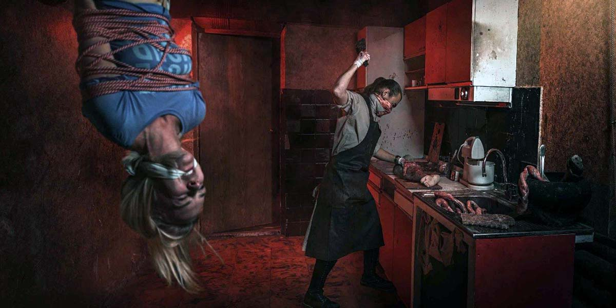 Killer hung the girl from the ceiling and is preparing to torture her